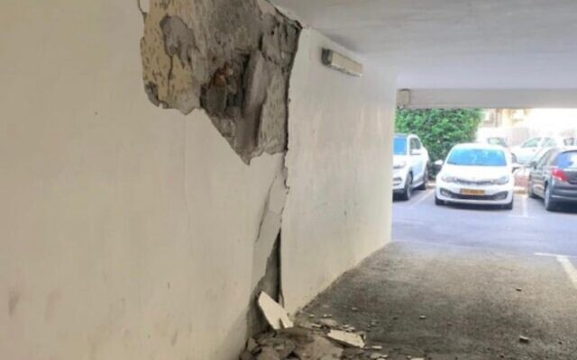 Cracks are seen in the walls of an apartment building in Holon on September 11, 2021. (Courtesy)