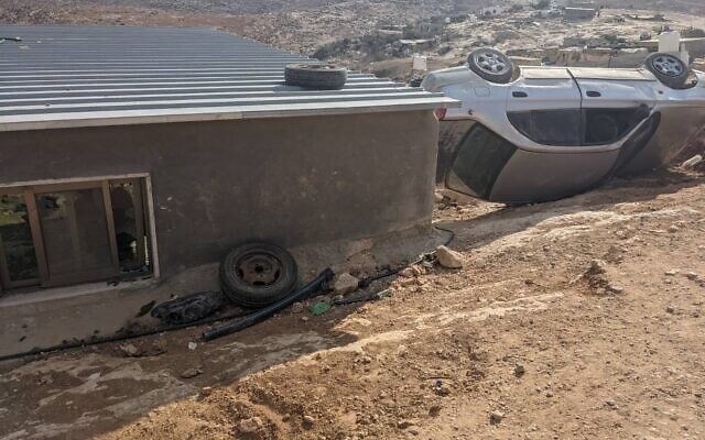 Smashed windows and a flipped over car, in what Palestinians say was an assault by dozens of masked settlers from a nearby Israeli outpost, on Tuesday, September 28, 2021, near the South Hebron Hills. (Courtesy)