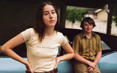 """Alana Haim and Cooper Hoffman in a promotional poster image for """"Licorice Pizza."""" (MGM via JTA)"""