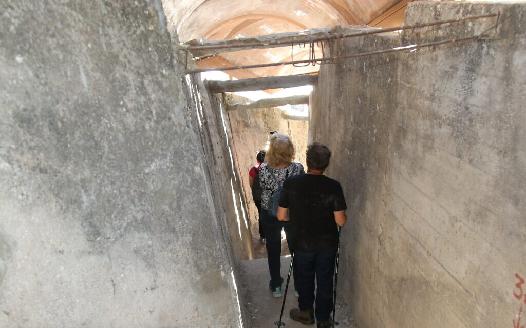 Descending the steps in the Mount Zion tunnel. (Shmuel Bar-Am)