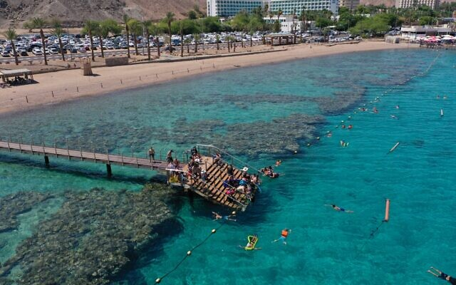 Swimmers enjoying a dip in the Red Sea at the Coral Beach Nature Reserve in Eilat, southern Israel, September 9, 2021. (Chen Toufikian, Israel Nature and Parks Authority)