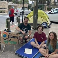 Fasting for climate outside the president's residence on September 10, 2021. From right: Michal Deutsch, Tamar Deutsch, Matanel Ciechanowski. (Sue Surkes/Times of Israel)