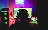 Illustrative: A young man is seen wearing a headset and playing an online computer video game. (DisobeyArt/iStock by Getty Images)