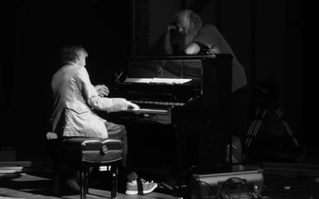Paul McCartney, playing the piano for producer Rick Rubin, in 'McCartney 3,2,1.' (YouTube screenshot/ Hulu)
