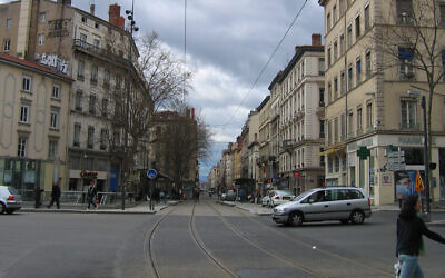 Pedestrians and cars cross Gebrial-Peri Square in Lyon, France, March 28, 2005. (Wikimedia Commons via JTA)