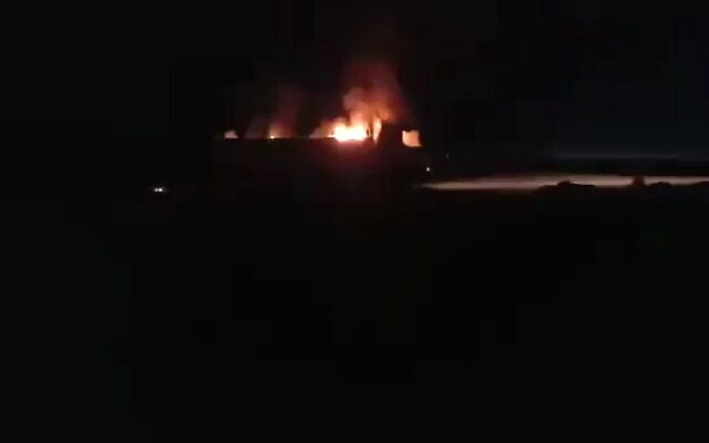 A burning vehicle is seen following a reported airstrike in the al-Bukamal region in Syria, near the border with Iraq, September 14, 2021. (Twitter/screenshot)