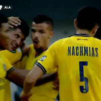 Maccabi Tel-Aviv players celebrate after Stipe Perica scores the first-ever goal of the UEFA Europa Conference League (Video screenshot)