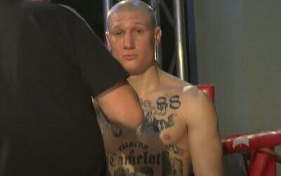 Italian boxer Michele Broili is seen sporting neo-Nazi tattoos in a 2018 fight (video screenshot)