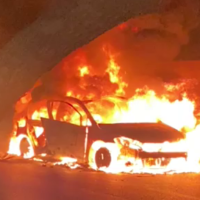 A burning car is seen by the entrance of Sajur on Sepetember 8, 2021. (Video screenshot)