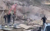 Building site workers are seen the site of the collapse in Kafr Kanna, September 28, 2021. (Video screenshot)