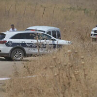 Police forces at the scene of the alleged murder of a 46-year-old woman from Nof Hagalil, near the Yarden Haharari section of the Jordan River, on August 7, 2021. (Israel Police)