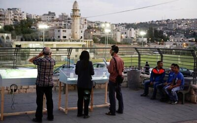 Gazing at exhibits that are part of Manofim, the Jerusalem art event opening October 27, 2021 (Courtesy Snir Katzir)