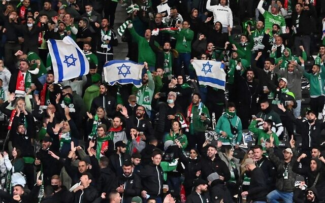 Israel's Maccabi Haifa fans display Israeli flags in the stands, during the UEFA Conference League Group E first leg football match between FC Union Berlin and Maccabi Haifa in the Olympic Stadium in Berlin, on September 30, 2021. (Matthias Koch/DPA/AFP/Germany Out)