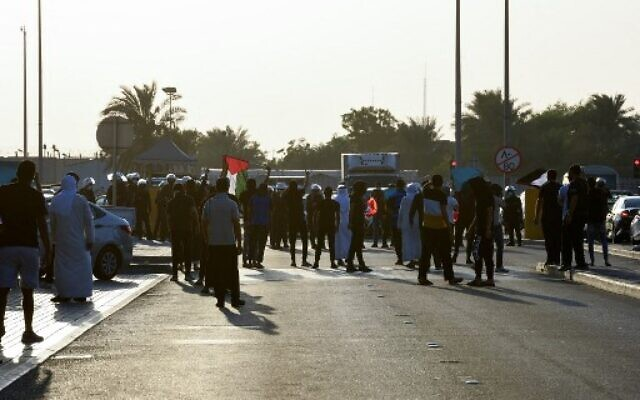 Protesters face-off with the police during an anti-Israel rally in Sitra island, south of the Bahraini capital, on October 1, 2021. - Several anti-Israel rallies took place across Bahrain to reject the opening of an Israeli embassy in Manama and express continued solidarity with the Palestinian cause. (Photo by Mazen Mahdi / AFP)
