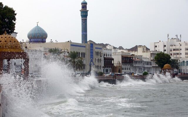 High waves break on the sea side promenade in the Omani capital Muscat on October 2, 2021, as the Shaheen tropical storm hits the country. (MOHAMMED MAHJOUB / AFP)