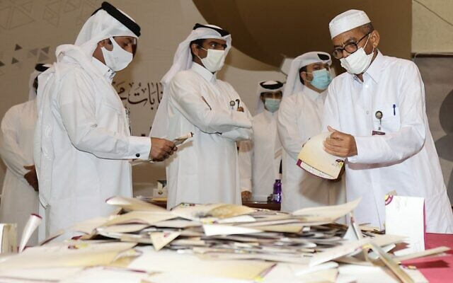 Qatari election officials count ballots at a polling station in the capital Doha, on October 2, 2021, after the polls closed on the country's first ever legislative vote. (Karim Jaafar/AFP)