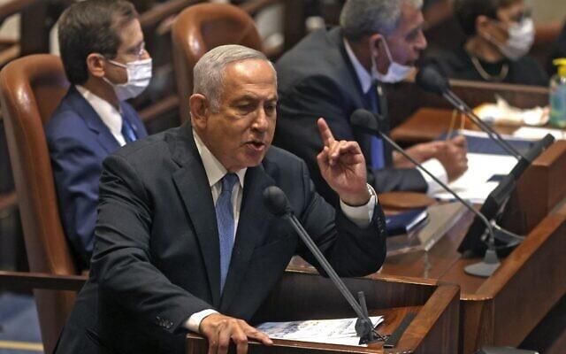 Opposition leader and ex-premier Benjamin Netanyahu addresses the opening of the Knesset's winter session, in Jerusalem on October 4, 2021. (Menahem KAHANA / AFP)