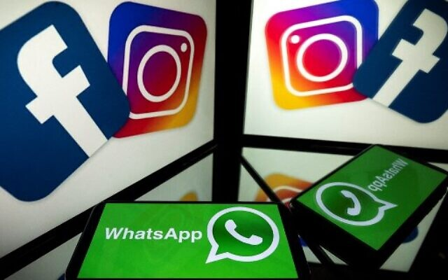 In this file photo taken on October 05, 2020 this picture shows logos of US social networks Facebook, Instagram and mobile messaging service WhatsApp on the screens of a smartphone and a tablet in Toulouse, southwestern France. (Photo by Lionel BONAVENTURE / AFP)