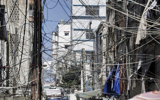 A mesh of raised electricity lines along a street in a suburb of Lebanon's capital Beirut, June 23, 2021. (Joseph EID / AFP)