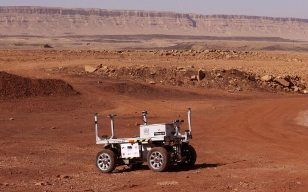 A robotic rover that is part of a team from Europe and Israel moves during a training mission for planet Mars at a site that simulates an off-site station at the Ramon Crater in Mitzpe Ramon in Israel's southern Negev desert on October 10, 2021.(Photo by JACK GUEZ / AFP)