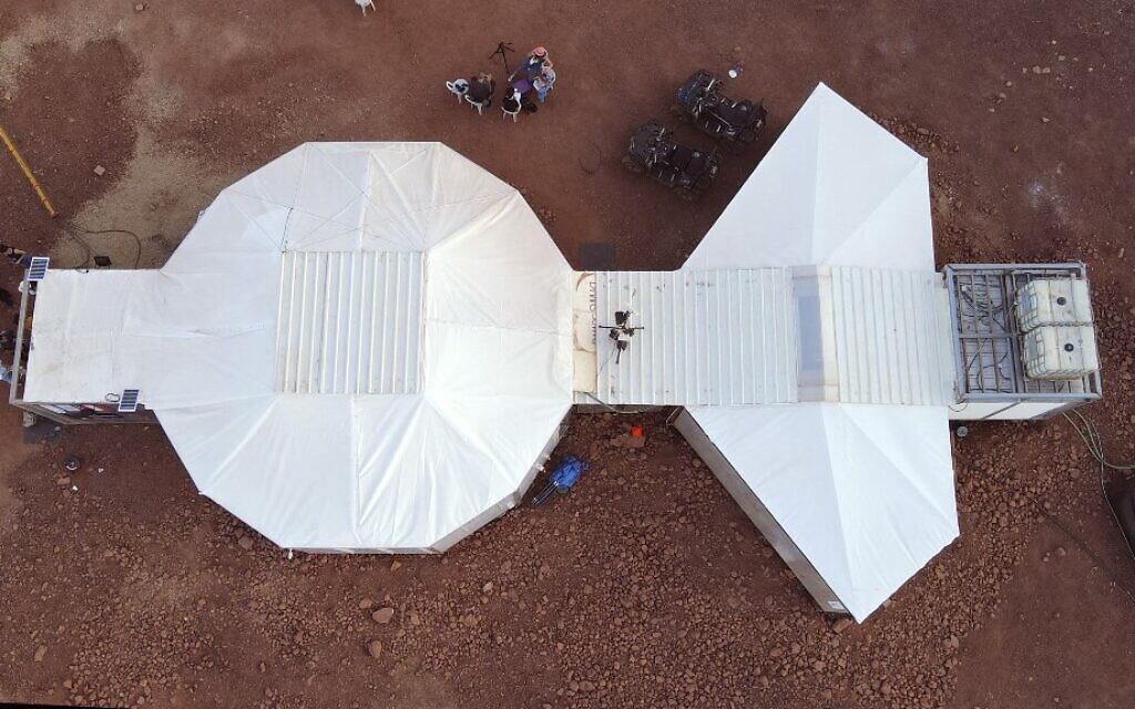 This picture taken on October 10, 2021 shows an aerial view of a habitat where astronauts from a team from Europe and Israel will participate in a training mission for planet Mars at a site that simulates an off-site station at the Ramon Crater in Mitzpe Ramon in Israel's southern Negev desert.  (Photo by JACK GUEZ / AFP)