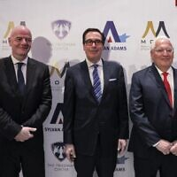 """(L to R) FIFA President Gianni Infantino, former US secretary of the treasury Steve Mnuchin, and former US ambassador to Israel David Friedman attend the launch of the """"Friedman Center for Peace through Strength"""" at the Museum of Tolerance Jerusalem on October 11, 2021. (Photo by Menahem KAHANA / AFP)"""