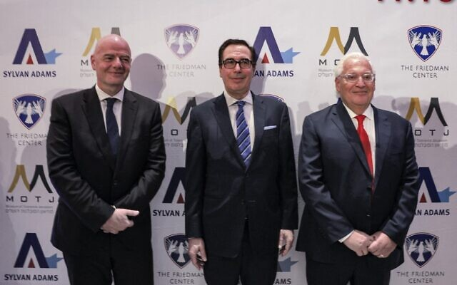"""(L to R) FIFA President Gianni Infantino, former US secretary of the treasury Steve Mnuchin, and former US ambassador to Israel David Friedman attend the launch of the """"Friedman Center for Peace through Strength"""" at the Museum of Tolerance Jerusalem on October 11, 2021. (Menahem KAHANA / AFP)"""