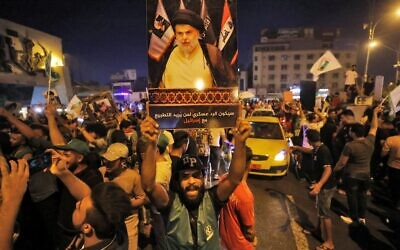 Supporters of Iraqi Shiite cleric Moqtada al-Sadr celebrate in Baghdad's Tahrir square following the announcement of parliamentary elections' results on October 11, 2021. (AHMAD AL-RUBAYE / AFP)