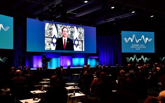 Israeli President Isaac Herzog speaks via video link during the Malmo International Forum on Holocaust Remembrance and Combating Antisemitism - Remember ReAct, in Malmo, Sweden, on October 13, 2021. (Jonas EKSTROMER / TT News Agency / AFP)