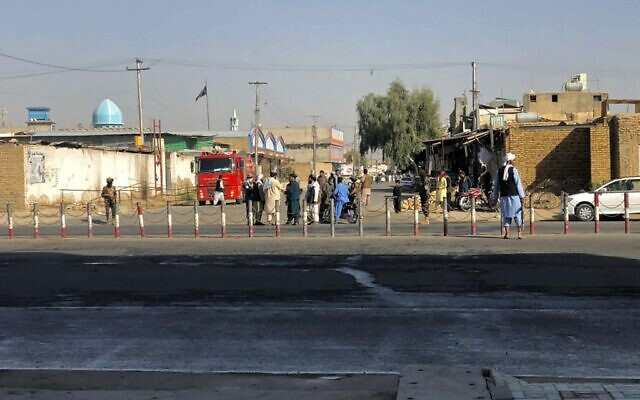 Members of the Taliban stand guard near a Shiite mosque in Kandahar province on October 15, 2021, after at least 16 people were killed and 32 wounded when explosions hit a Shiite mosque. (JAVED TANVEER / AFP)