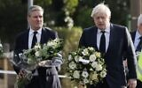 Britain's Prime Minister Boris Johnson (R) and Britain's main opposition Labour Party leader Keir Starmer carry floral tributes as they arrive at the scene of the fatal stabbing of Conservative British lawmaker David Amess, at Belfairs Methodist Church in Leigh-on-Sea, a district of Southend-on-Sea, in southeast England on October 16, 2021 (Tolga Akmen / AFP)