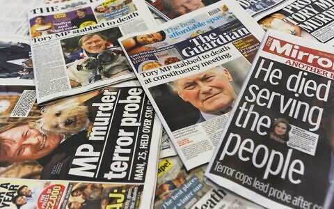An arrangement of UK daily newspapers photographed in London on October 16, 2021 shows front page headlines reporting on the fatal stabbing of British lawmaker David Amess. (DANIEL SORABJI / AFP)