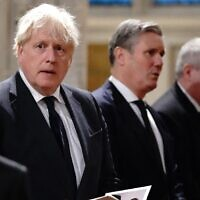 Britain's Prime Minister Boris Johnson (L), Britain's main opposition Labour Party leader Keir Starmer (C) and Scottish National Party (SNP) Westminster leader Ian Blackford attend a service of prayer and remembrance in honor of slain British lawmaker David Amess, at St Margaret's Church in London, October 18, 2021. (Jonathan Brady/ Pool/ AFP)