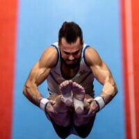 Israel's Andrey Medvedev competes in the vault event at the men's apparatus finals during the Artistic Gymnastics World Championships at the Kitakyushu City Gymnasium in Kitakyushu, Fukuoka prefecture, on October 24, 2021. (Philip Fong/AFP)