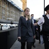 """Facebook whistleblower Frances Haugen (L) leaves the Houses of Parliament in central London on October 25, 2021 after giving evidence to members of the UK parliament on the Joint Committee on the draft Online Safety Bill. - Facebook whistleblower Frances Haugen told UK lawmakers Monday that posting content featuring anger and hate """"is the easiest way to grow"""" on the social media platform as she urged better regulation. The ex-Facebook employee, who earlier this year shared a trove of internal documents alleging it knew its products were fueling hate and harming children's mental health,  argued the platform was """"unquestionably"""" fuelling hate. (Photo by Tolga Akmen / AFP)"""