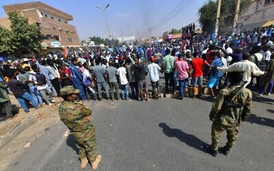 Sudanese security forces keep watch during protests against a military coup that overthrew the transition to civilian rule, on October 25, 2021, in the capital Khartoum's twin city of Omdurman. (AFP)