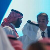 Saudi Crown Prince Mohammed bin Salman (left) and Greek Prime Minister Kyriakos Mitsotakis (right) participate in a session at the annual Future Investment Initiative conference in the Saudi capital Riyadh, on October 26, 2021. (Fayez Nureldine/AFP)