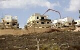 This file photo from October 13, 2021, shows construction in the Israeli settlement of Rahalim, located near the Palestinian village of Yatma, south of Nablus in the northern West Bank. (Jaafar Ashtiyeh/AFP)