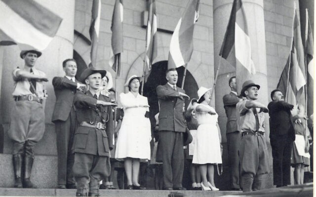 Members of the South African pro-German group the Ossewabrandwag perform their salute in this undated photo from circa WWII. (Courtesy OB Archive, North-West University, South Africa)
