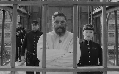 """Benicio del Toro, center, as painter Moses Rosenthaler, and Léa Seydoux, right, as the prison guard Simone in """"The French Dispatch."""" (Searchlight Pictures via JTA)"""
