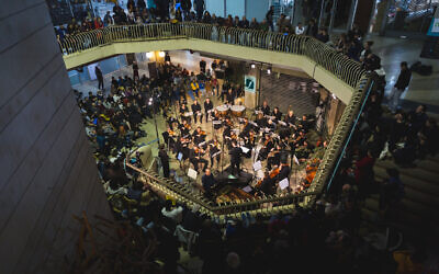 The Jerusalem Street Orchestra performing at the city's Clal Building, a classical musical festival returning October 26-28, 2021 (Courtesy Jerusalem Street Orchestra)