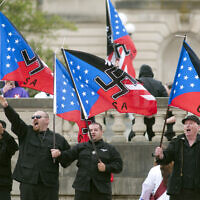 FILE -- Members of the National Socialists Movement and the White Knights of the Klu Klux Klan salute during a rally April 21, 2012, at the Capitol in Frankfort, Kentucky (AP Photo/John Flavell)