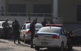 Illustrative: Police officers stand at the civil police headquarter in Rio de Janeiro, Brazil, June 29, 2017.  (Leo Correa/AP)