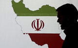 Illustrative: A cybersecurity expert stands in front of a map of Iran as he speaks to journalists about the techniques of Iranian hacking, on September 20, 2017, in Dubai, United Arab Emirates. (AP/Kamran Jebreili)