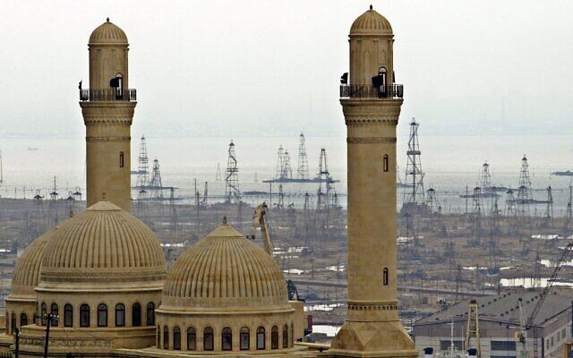 Illustrative: Oil derricks in the background beyond the Bibi Heybat Mosque in Baku, Azerbaijan, on March 3, 2006. (AP Photo/Mikhail Metzel, File)