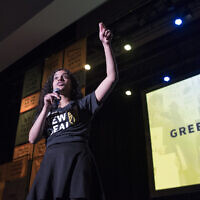 Sunrise Movement co-founder Varshini Prakash addresses The Road to the Green New Deal Tour final event at Howard University in Washington, Monday, May 13, 2019. (AP/Cliff Owen)