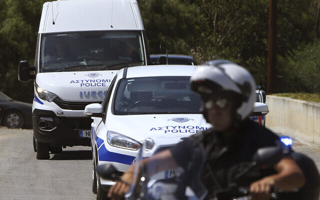 Illustrative -- A motorcyclist police officer escorts and guards a police van, Nicosia, Cyprus, June 24, 2019 (Petros Karadjias/AP)