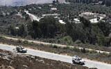 Illustrative:  Sept. 2, 2019, file photo, Spanish UN peacekeepers patrol along the Lebanese-Israeli border, with the Israeli village of Metulla in the background(AP Photo/Hussein Malla, File)