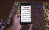 Illustrative -- In this April 25, 2020, photo, a man reads the holy Quran on his phone during the first day of Ramadan in Mumbai, India  (AP Photo/Rafiq Maqbool)