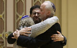 Rabbi Jeffrey Myers, right, of Tree of Life/Or L'Simcha Congregation hugs Rabbi Cheryl Klein, left, of Dor Hadash Congregation and Rabbi Jonathan Perlman during a community gathering held in the aftermath of a deadly shooting at the Tree of Life Synagogue in Pittsburgh, October 28, 2018.  (AP Photo/Matt Rourke, File)